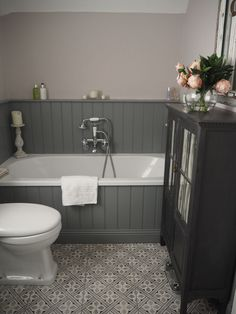 Bathroom - grey panelling against bath and we have scrapped the roll top bath idea! Old style rain shower over bath