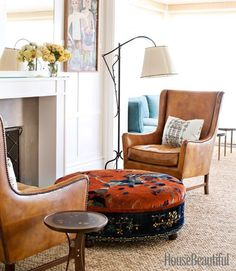 Living Room -  leather chairs, upholstered ottoman in rich fabric