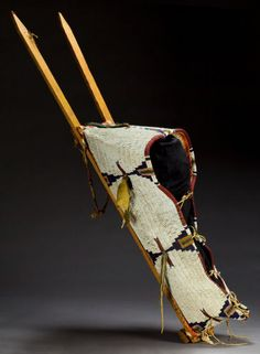 American Indian Art:Beadwork and Quillwork, A CHEYENNE BEADED HIDE BABY CARRIER. c. 1890...