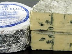Oxford Blue - With a view to overcome the lack of semi-soft English blue cheeses apart from Stilton, Oxford Cheese Company's MD, Baron Robert Pouget along with Steve Peace from Hartington creamery first produced Oxford Blue cheese at the Oxford Cheese Company in 1994. They wanted to make a cheese that could rival imports such as Dolcelatte, Cambozola and Fourme D'Ambert.     Oxford Blue cheese is a full-fat semi-soft Stilton-type blue cheese with a creamy texture and sharp clean flavor.