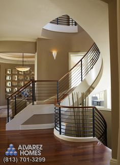 The Staircase of The Audrey by Home Builders in Tampa Alvarez Homes - (813) 701-3299 Fascinating staircase. http://www.alvarezhomes.com/tampa-home-builders-portfolio-of-homes/the-audrey