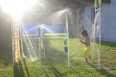 DIY Splash Park in your back yard!!! One of these days I'll have one!