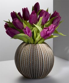 Eye catching vase with purple tulips.