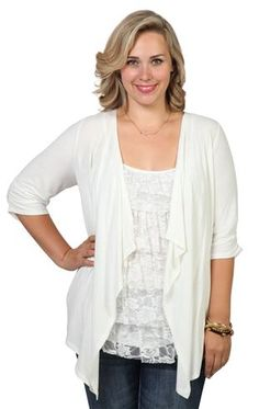plus size knit cozy with tiered inset and elbow length sleeves