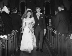 Phil Everly, 23, of the singing Everly Brothers, and Jacqualine Alice Ertel walk down the aisle following their wedding ceremony on Jan. 12, 1963 in New York City. (AP Photo)