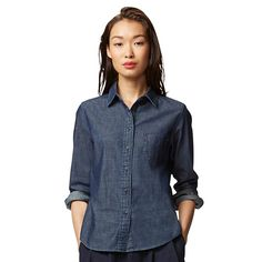 This casual shirt made with thick denim features a rich, textured indigo color. Wide buttons add a refined look, and print fabric inside the collar provides durability and a touch of style.