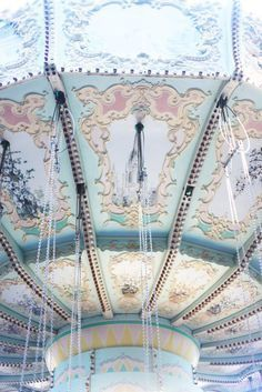Carousels. Elizabeth's father always took her to them during the first day of every season and on Christmas, New Years, and her birthday.