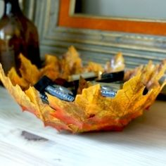 PIN NOW READ LATER!!!Learn how to make this easy Fall DIY using leaves, mod podge, and the paper mache technique. Perfect for Thanksgiving crafting and decor!