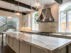 This huge marble island is great for extra entertainment seating or for chef-inspired meal prep.