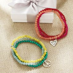 triple bead bracelets with one silver charm