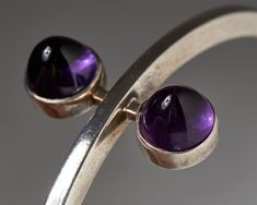 Designed by Hans Hansen, Denmark. 1950's. Sterling silver and amethysts. Inner diameter: 6,8 cm/ 2 5/8''