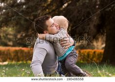 Happy father and son portrait playing together having fun by Aleksandr Ryzhov, via Shutterstock