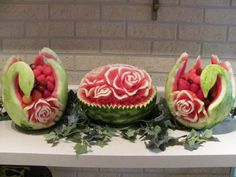 Watermelon swans fruit bowls and roses centerpieces.