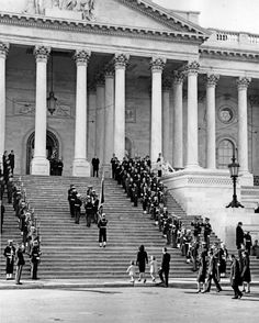 Jacqueline Kennedy, Caroline Kennedy, John F. Kennedy Jr., Robert F. Kennedy, Stephen Smith, Jean Kennedy Smith and Secret Service agent Cling Hill follow the casket bearing President Kennedy up the stairs of the U.S. Capitol for the lying in state at the United States Capitol in Washington, D.C., on Nov. 24