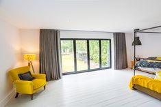 This modern, industrial bedroom has come alive with these yellow & grey blinds & curtains for bi fold doors in Woking, Surrey. Curtains For Bifold Doors, Curtains With Blinds, Door Curtains, Dining Room Curtains, Curtains Living, Vertical Window Blinds, Door Coverings, Grey Blinds, Outdoor Blinds