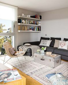 I really like the bookshelf over the part of the couch with no back! classy living room for a small space