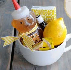 A Get Well Kit : large mug, honey, fresh lemon, echinacea tea bag, chapstick, tissues, throat drops (insert lemon honey tea directions: squeeze half of a lemon & honey into bottom of cup, put squeezed lemon half & tea bag in cup, add hot water & steep 10 minutes) -- Keep on hand to give to people when they are sick. Gift basket Ideas #giftbasketideas #giftbaskets
