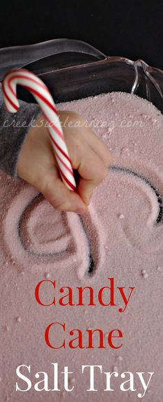 Handwriting practice with candy canes in the salt tray. Sensory writing with a wonderful peppermint smell.