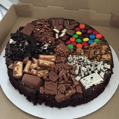 Brownie pizza  with nutella, chocolates and cookies