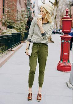 Striped sweatshirt (tucked in), green track pants, brown high heel clogs, cream beanie