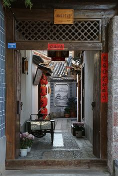 A shared residential laneway with a gate in Lijiang, Guangxi province, in southwest China #laneway #walkway