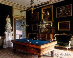 Chateau de Groussay, France. The billiard room is furnished with an antique biliard table with impressive pendant lights
