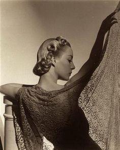 Photo by Horst P. Horst (1906-1999), German-American fashion photographer.  Lighting, fabric, tone.