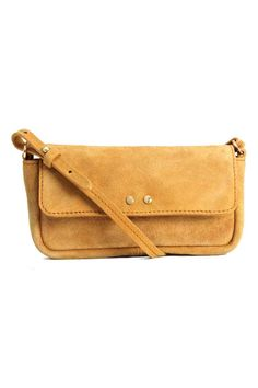 Suede shoulder bag: PREMIUM QUALITY. Small suede shoulder bag with a flap and magnetic fastener at the top and a detachable, adjustable shoulder strap. Lined. Size 3.5x9x20 cm.