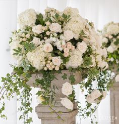 white and champagne urn arrangements with hydreangeas and roses