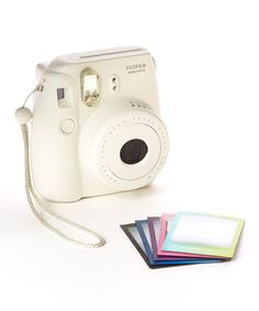 This is one of my favorite things to give this holiday season! And Zulily has it on sale this week. They also have a pink one! :: White Instax Mini 8 Camera & Film Set