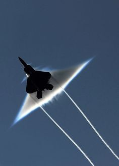 Here we see an Air Force F-22 Raptor making a supersonic flyby over the aircraft carrier USS John C. Stennis, which was participating in the joint exercise Northern Edge 2009.