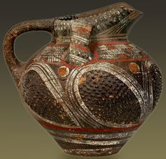 Painted Kamares ware ewer or pitcher with three handles and relief spiky decoration, Palaeopalatial Period (1900 – 1700 BC) Heraklion Museum