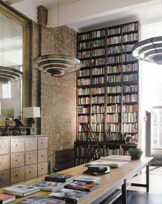 Super high ceiling feature wall of books, love