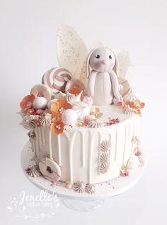 Orange bunny drip cake. By Jenelle's Custom Cakes.
