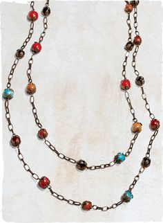 Bright ceramic beads light up the extra-long bronze chain necklace, shown doubled for dramatic effect.