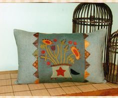Wool applique pillow really like the finishing on this with the prairie points