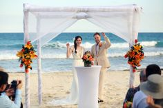 Riviera Maya Wedding at @Valentin Imperial Maya All-Inclusive newlyweds with a fist pump to celebrate their love on the beach!  Mexico wedding photographers Del Sol Photography