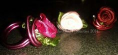 Rings for the little ones...pink, fushia and red used with little fabric roses and 2mm aluminium