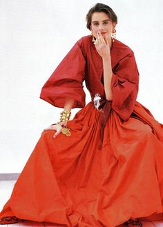 Oscar de la Renta was trained by Balenciaga, worked for Elizabeth Arden, and has been one of the world's most successful designers for over 40 years. It's not hard to see why: His peasant blouse and skirt in silk taffeta are just glorious, their colors evocative of lush autumn foliage. Photo from Mirabella, February 1990.