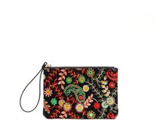 Wristlet in navy blue floral embroidery.