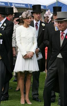 Kate Middleton Cocktail Dress Kate wore a white chiffon cocktail dress under her sophisticated jacket for the Epsom Derby.