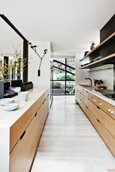 modern kitchen with wood cabinets and white countertops