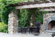 dreamy stone pergola - imagine it made with field stone & reclaimed barn wood!