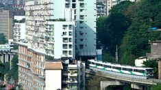 A city train running through an apartment complex. (Image: Weibo.com) http://www.visiontimes.com/2016/02/10/the-3d-city-of-mountains-the-unusual-yet-magical-chongqing.html
