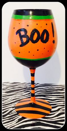 Halloween Hand Painted Wine Glasses. Black, orange in glitter and BOO! GLOWS in the dark. Non-Toxic and Hand Washable