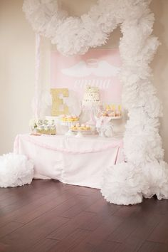 Reveal: Little Angel First Birthday Party Angel-Themed First Birthday for a Miracle Baby - we love the fluffy tissue pom garland!Angel-Themed First Birthday for a Miracle Baby - we love the fluffy tissue pom garland! Birthday Party Table Decorations, Birthday Party Desserts, Birthday Party Tables, Baby Birthday, 1st Birthday Parties, Birthday Angel, Birthday Garland, Birthday Ideas, Dessert Party