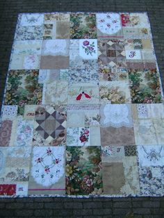 Quilt with sanderson fabric, lace, embroideries, damask fabric, roses and so on....