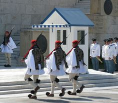 """The Presidential Guards (""""Evzones"""") guard the Tomb of the Unknown Solder which is located in front of the Greek Parliament Building"""