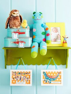I love how they displayed their kid's art in these hanging frames...and they cut out the actual pictures they colored and then pasted on cute scrapbooking paper. ADORABLE!