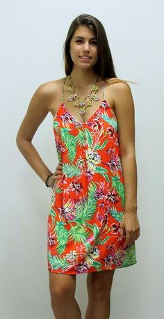 GO TROPICAL in this beautiful floral dress. We can already feel the ocean breezes just looking at it! New and in store! $48